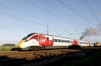 EDITORIAL USE ONLY Virgin Trains' new Azuma travels in the same direction alongside the The Flying Scotsman and two of the rail operator's revitalised present day fleet - to depict the past, present and future of UK rail travel, in a world first event, in the North Yorkshire countryside.