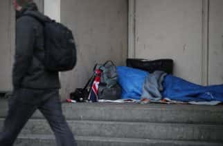 File photo dated 07/02/17 of a person sleeping rough in a doorway, as bosses at a charity which helps homeless people say benefits changes are forcing European Union immigrants to sleep rough.