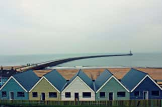 Roker Pier and houses on an overcast day.