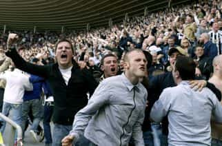 Newcastle United fans celebrate going ahead in the North East derby