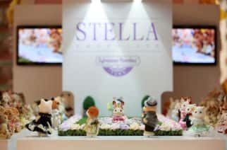 EDITORIAL USE ONLY Figurines on the catwalk at the opening of the world's smallest fashion show, celebrating the launch of the new Sylvanian Families Town at Hamleys Regent Street in London.