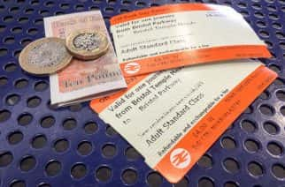 File photo dated 14/8/2018 of off-peak day return rail tickets and money. Britain's rail fares will increase by an average of 3.1% on January 2, industry body the Rail Delivery Group said.