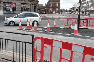 Pedestrians discuss roadwork difficulties in Sunderland city centre