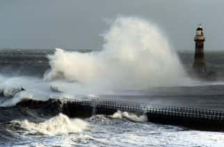 Gale force winds crash waves from the North Sea into the Roker Lighthouse in Sunderland.