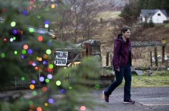 PA Images: A woman leaves a polling station after voting at Gersask Primary School, Laggan in the Cairngorms.