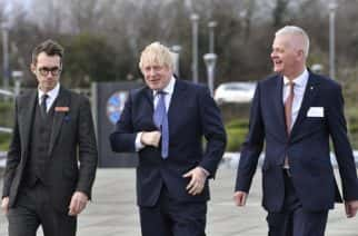 Britain's Prime Minister Boris Johnson, centre, arrives for a cabinet meeting at the National Glass Centre at the University of Sunderland, the city which was the first to back Brexit when results were announced after the 2016 referendum. Friday, Jan. 31, 2020. Britain officially leaves the European Union on Friday. (Paul Ellis/Pool photo via AP)