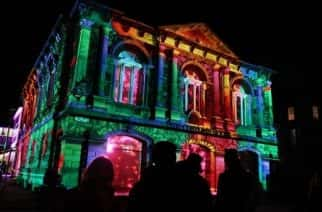 "The Customs House which hosts ""Everywhere We Go"" for the second year running is illuminated by a projection called ""Heart of The House"", designed by NOVAK, to celebrate its 25th anniversary."