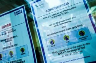 Signs offer advice regarding the covid-19 coronavirus in a window at the entrance to University College Hospital, which houses a 'coronavirus pod' isolation unit, in London, England, on February 27, 2020. Concern continues over the pandemic potential of the virus, with cases now being confirmed in a steadily increasing number of countries around the world. Two further coronavirus cases were confirmed today in the UK, bringing the total so far to 15. (Photo by David Cliff/NurPhoto)