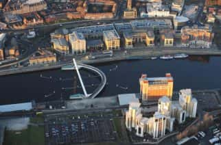 Aerial view of Newcastle city centre showing the Gateshead Millennium Bridge (also know as the 'Blinking Eye Bridge'), and The Baltic Arts Centre.