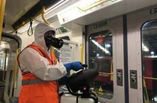 A metro train being cleaned using the new disinfectant spray. Credit: Nexus