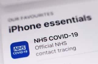 The new coronavirus contact tracing app on an iPhone, which was launched across England and Wales on Thursday morning.