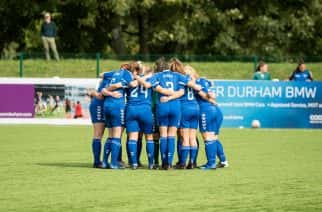 Durham Women FC in a pre-match huddle.