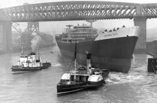 Tugs move in to take hold of the ship Victoria City after the launch at William Doxford and Sons shipyard on the River Wear at Sunderland.