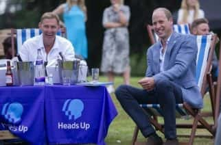 Prince William, the Duke of Cambridge, with former Arsenal player Tony Adams during a screening of the Heads Up FA Cup final between Arsenal and Chelsea, at the Sandringham Estate in Norfolk, to mark the culmination of the Heads Up campaign on mental health.