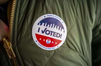 """A voter wears her """"I Voted"""" sticker on Election Day in New York on Tuesday, November 3, 2020. (Photo by Richard B. Levine)"""