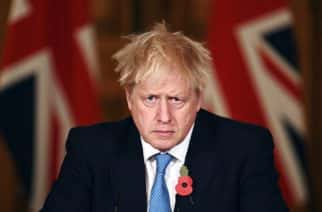 Britain's Prime Minister Boris Johnson attends a media briefing on coronavirus, in Downing Street, London, Thursday, Nov. 5, 2020, Britain is joining large swaths of Europe in imposing new restrictions to save the health care system from being overwhelmed. England-wide, pubs, restaurants, hairdressers and shops selling non-essential items such as books and sneakers will have to close Thursday until at least Dec. 2. (Leon Neal/Pool Photo via AP)