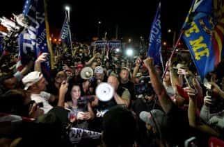 Far right radio host Alex Jones walks through a rally of pro-Trump supporters outside the Maricopa County Recorder's Office, in Phoenix. Photo: AP Photo/Matt York