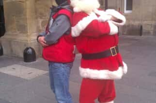 Earl Charlton has been selling 'The Big Issue' for 18 years. Here is with Santa at Central Station Newcastle.