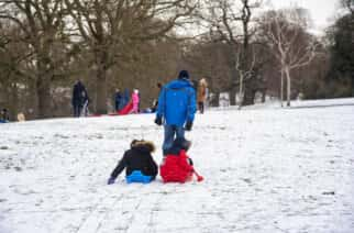 Families have been occupying themselves with snow in the North East - but this has prompted warnings about social distancing.