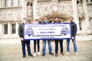 Uber drivers with Yaseen Aslam (second right) outside the Supreme Court, London, after Supreme Court justices ruled against Uber operating companies and concluded that drivers should be classed as workers, not independent third-party contractors.