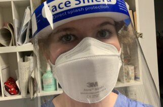 Nurse Amy Mansfield on hospital ward in full PPE