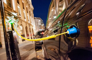 PXMX0P Electric car charging up on a city street charge facility, UK, London