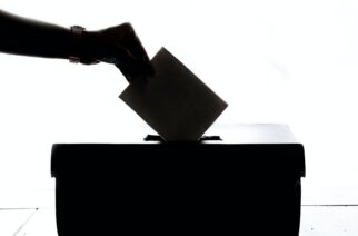 How do students vote in elections and are they encouraged to vote?